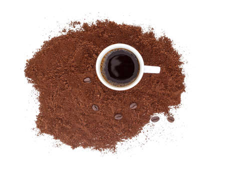 Strong, black espresso in a white cup, with freshly ground coffee and beans. Isolated on white background.