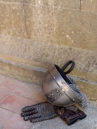 Medieval, mediaeval knight helmet and chain mail gloves.
