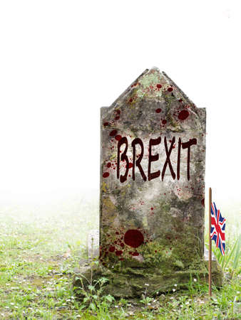 Brexit dead, UK politics. Ancient gravestone in fog, with blood and bedraggled flag. Zdjęcie Seryjne