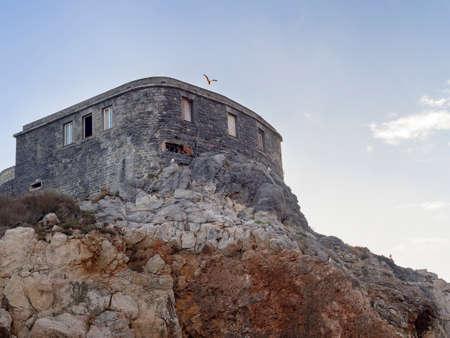 Lookout, fortification near Portovenere, Liguria, Italy. With bird. Reklamní fotografie