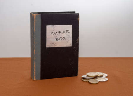 Vintage swear box, with Euros. New Year Resolution maybe.
