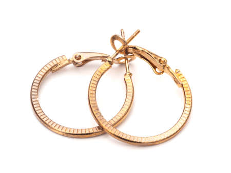 Vintage gold colour hoop earrings, pair, on white background. Foto de archivo