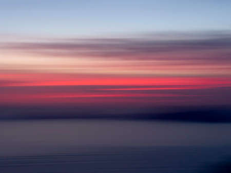 Palmaria sunset, scenic Liguria with intentional camera movement for beautiful blurry effect. Gulf of poets.