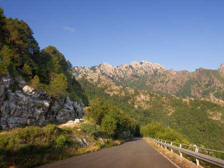 Mountain road in the Apuan Alps, Alpi Apuane, near the Vestito Pass. Above Massa Carrara, Italy. Open road, travel.