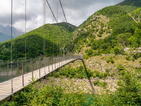 Suspension pedestrian bridge over Vagli Lake near Vagli di Sotto village in Lucca province, Italy, with no identifiable people. Archivio Fotografico