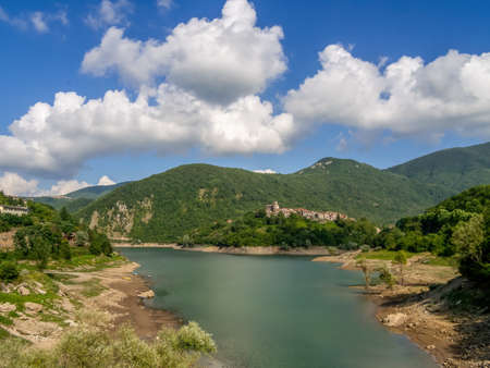 View of Lago ie Lake Vagli in Garfagnana, province of Lucca, Italy with Vagli Sotto village visible.It is a madmade reservoir for hydroelectric energy