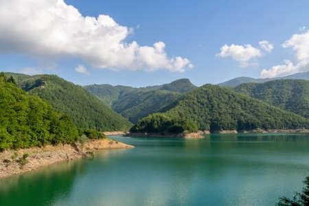 Part of unspoilt natural view around Lago ie Lake Vagli in Garfagnana, province of Lucca, Italy. Near Vagli Sotto village.