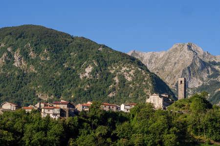 Vagli Sopra village with Apuan Alps behind. Garfagnana area of Italy.