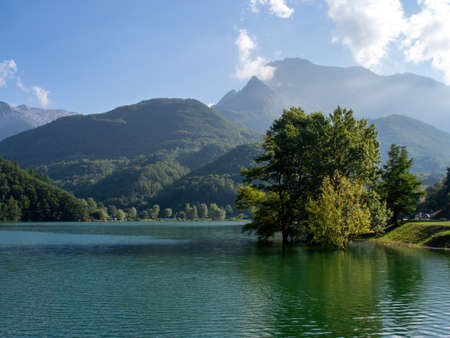 Gramolazzo Lake in Garfagnana, Italy. A beautiful area for holidaymakers in a less well known area of Italy. Apuan Alps behind.