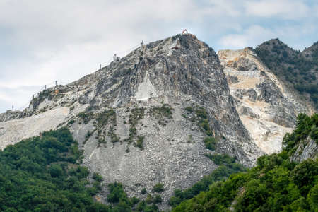 Mountain peak in the Apuan Alps, Italy, showing marble quarries at base. Enironmental damage.