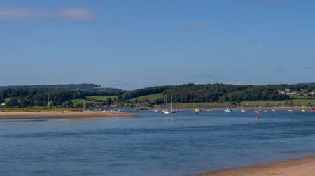 Sunny day view of the river Exe estuary at Exmouth, with assorted unidentifiable boats moored. Devon, England.