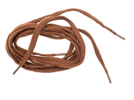 Pair of classic flat brown shoe laces isolated on white background.