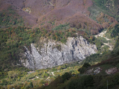 View over the white outcrop of chalk gypsum rock which gives its name to Sassalbo, in the comune of Fivizzano, Lunigiana, Italy. Imagens