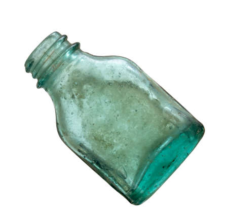 Very old green glass medicine bottle isolated on white. Looks hand blown. Stock Photo