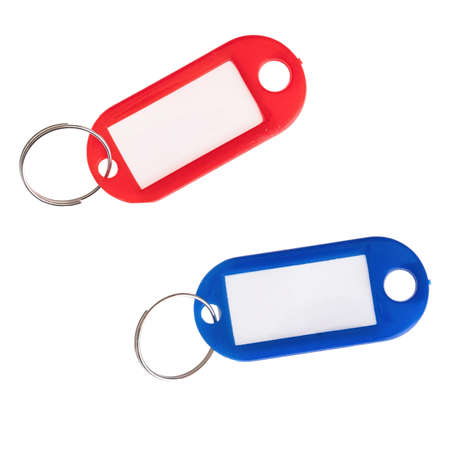 Colorful red and blue blank plastic key rings isolated on white background. With space for address or label. Banque d'images