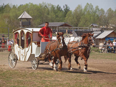 adroitness: a cossack manages a coach on the festival of equestrian art Editorial