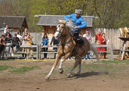 adroitness: rider on a horse galloping