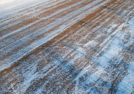 Fragment of a slippery asphalt road, covered snow photo