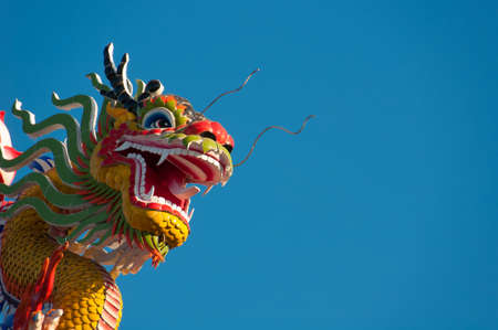 custodian: Dragon statue on pillar and blue background  Stock Photo