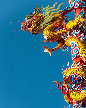 dialectic: Dragon statue on pillar and blue   Stock Photo