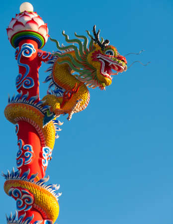 dialectic: Dragon statue on pillar and blue background  Stock Photo