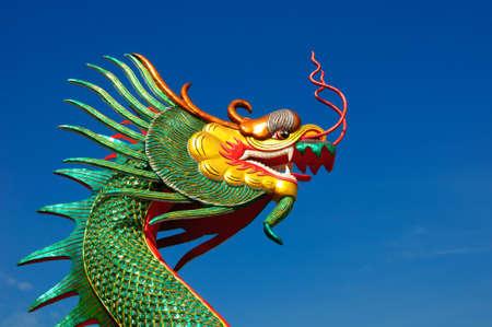 minutiae: Dragon head statue on blue background  Stock Photo