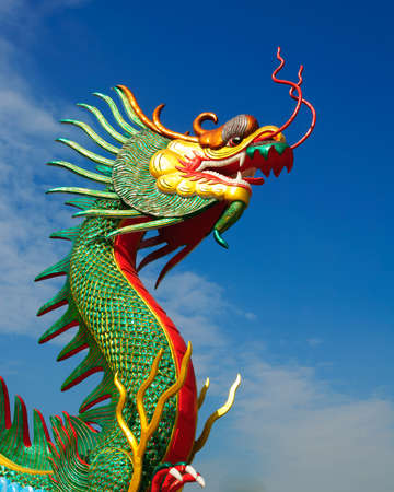 dialectic: Dragon head statue on blue
