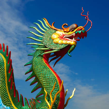 minutiae: Dragon head statue on blue