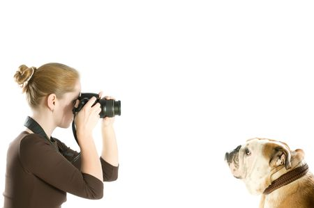 beautiful woman shooting her pet isolated on white