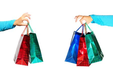 Hand holding gift bags isolated on white background  photo