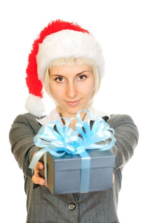 Woman in santas hat holding gift box isolated on white background. Focus on gift  photo