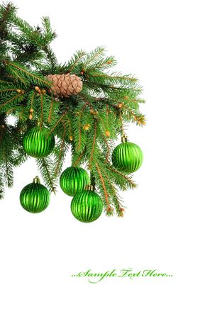 Pine branches and green christmas balls isolated on white background  photo