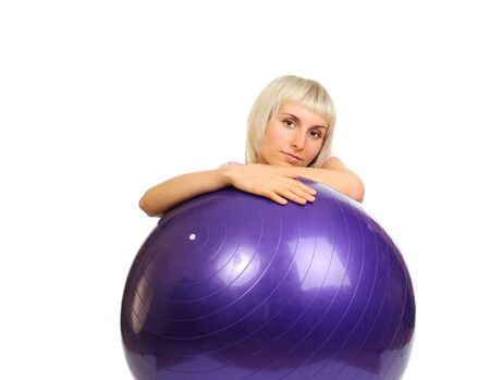 Girl on blue ball isolated on white background Stock Photo - 6068120