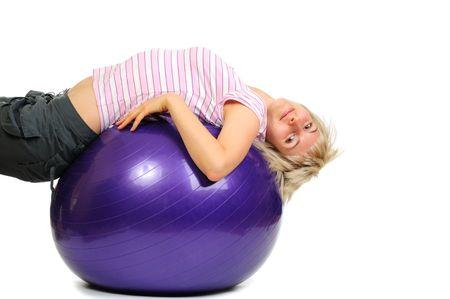 Girl on blue ball isolated on white background  photo