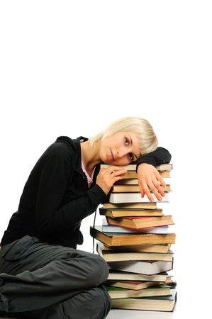 overachiever: Young woman with stack of books isolated on white background Stock Photo