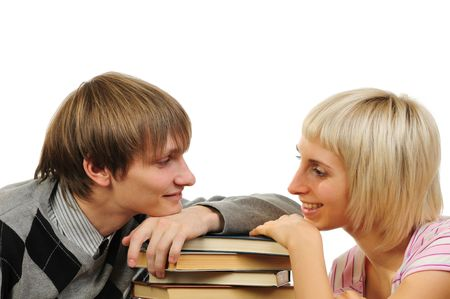 overachiever: Young couple with stack of books isolated on white background