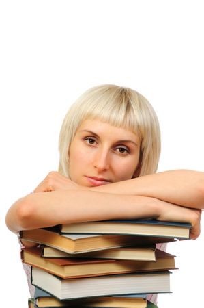 Young woman with stack of books isolated on white background photo