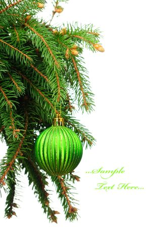 Pine branches and green christmas ball isolated on white background  photo