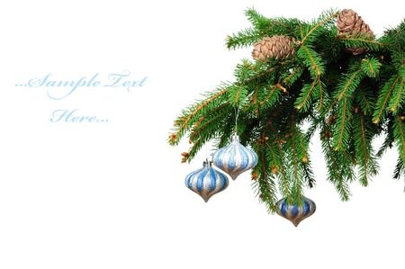 Pine branches and christmas toys isolated on white background  photo