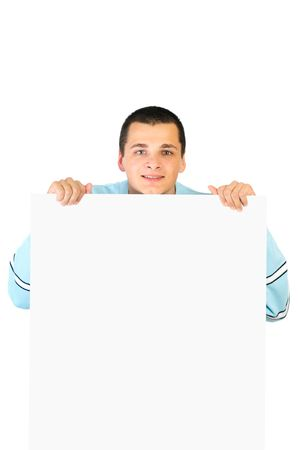 Portrait of a young man with a blank banner isolated on white background photo