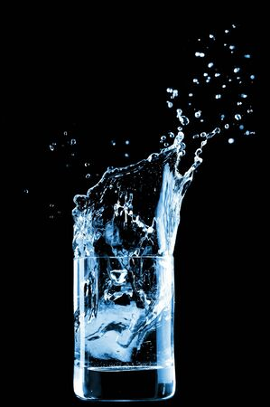 Water in glass isolated on black background
