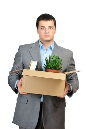 You are fired! Young businessman hold cardboardbox with personal belongings. Isolated on white background.  Standard-Bild