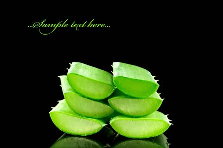 Sliced aloe leaves isolated on black background  photo
