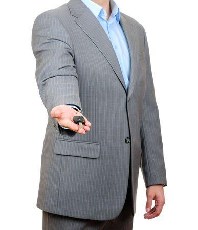 Businessman holding key isolated on white background  photo
