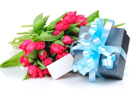Tulips and gift box with blue ribbon isolated on white background  photo