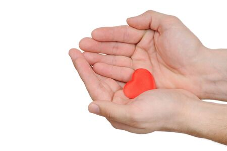 Valentine heart in female hands isolated on white background  photo