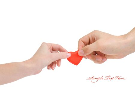 Valentine heart in male and female hands isolated on white background  photo