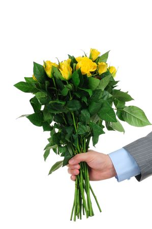heart suite: Man hand holding bunch of yellow roses isolated on white background