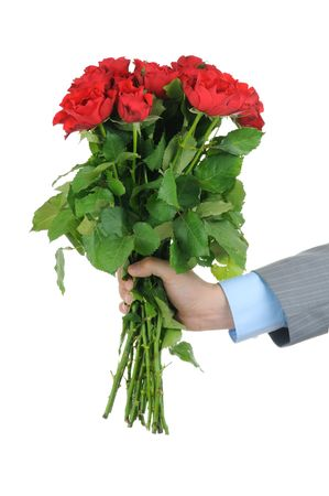 Man hand holding bunch of red roses isolated on white background photo