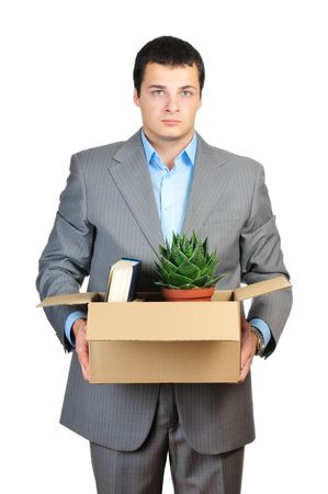 You are fired! Young businessman hold cardboardbox with personal belongings photo